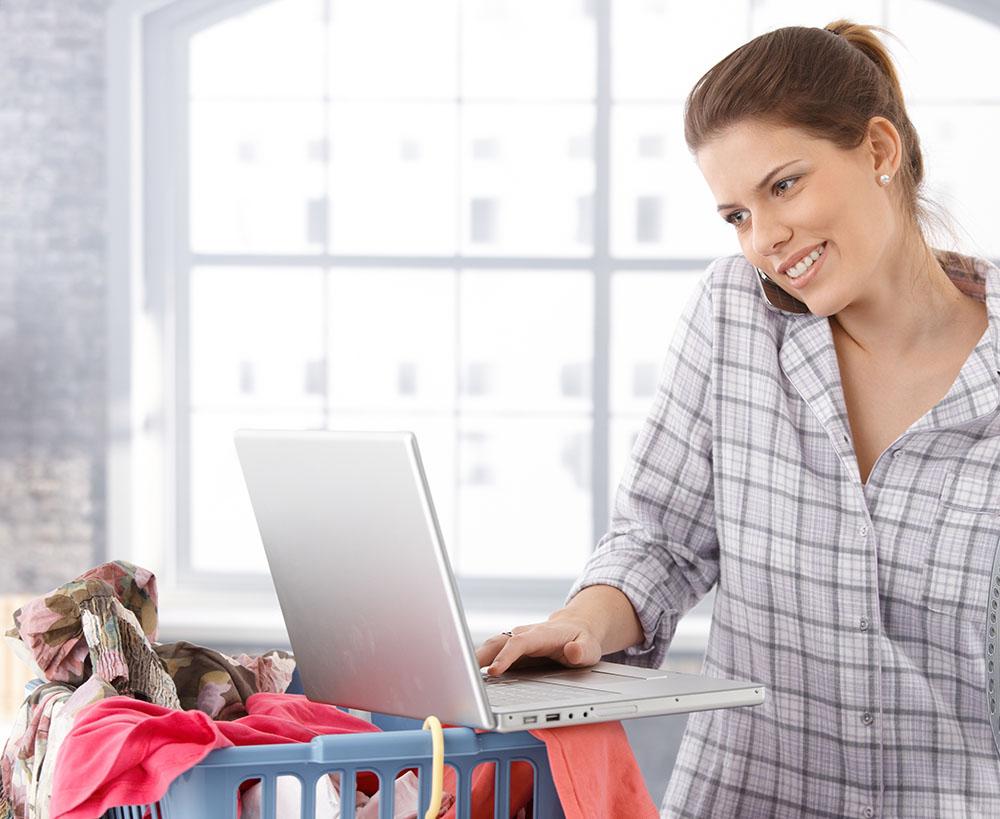 Multitasking woman at home
